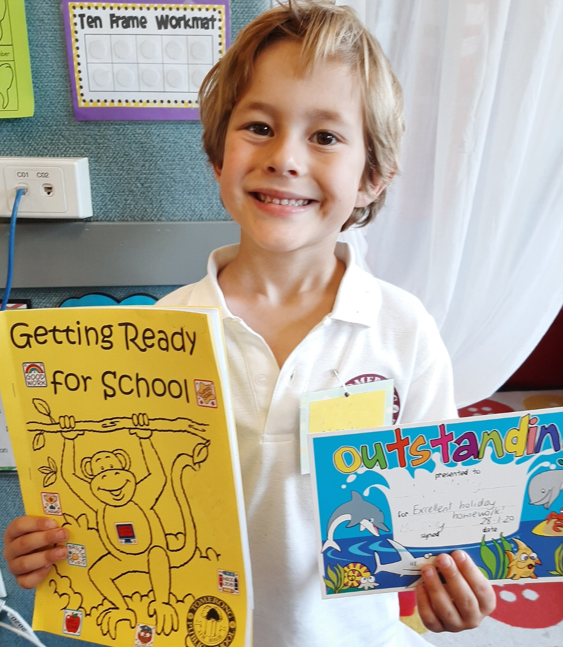 Child with getting ready for school booklet and certificate